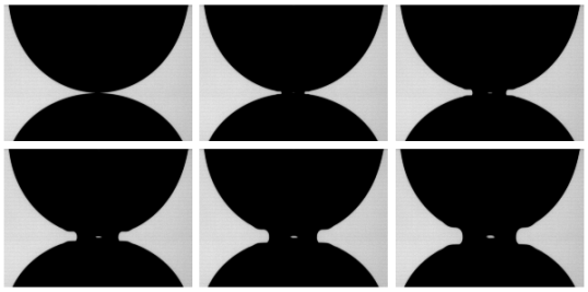 Initial moments of coalescence for two millimeter-size water drops. Frames are 120 μs apart. The central white spot is due to the light source located behind the drops.